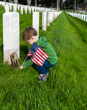 Child decorates great grandfather's grave on Memorial Day