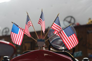 Antique fire engine displays flags on radiator cap